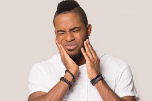 Man with bad toothache should visit his Braintree emergency dentist